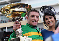 National Hunt Horse Racing - 2020 Cheltenham Festival - Tuesday, Day One (Champion Day)<br /> <br /> Winner, Barry Geraghty on Epatante with the trophy and his wife, in the 15.30 Unibet Champion hurdle challenge trophy ( Class 1), at Cheltenham Racecourse.<br /> <br /> COLORSPORT/ANDREW COWIE