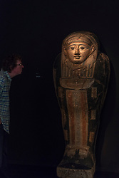 "© Licensed to London News Pictures. 28/06/2018. LONDON, UK. A visitor views an Egyptian ""Sarcophagus cover"", 4th century BC. Members of the public visit Masterpiece London, the world's leading cross-collecting art fair held in the grounds of the Royal Hospital Chelsea.  The fair brings together 160 international exhibitors presenting works from antiquity to the present day and runs 28 June to 4 July 2018.  Photo credit: Stephen Chung/LNP"