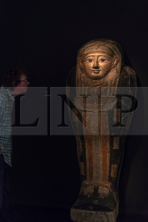 """© Licensed to London News Pictures. 28/06/2018. LONDON, UK. A visitor views an Egyptian """"Sarcophagus cover"""", 4th century BC. Members of the public visit Masterpiece London, the world's leading cross-collecting art fair held in the grounds of the Royal Hospital Chelsea.  The fair brings together 160 international exhibitors presenting works from antiquity to the present day and runs 28 June to 4 July 2018.  Photo credit: Stephen Chung/LNP"""