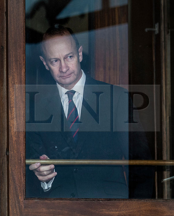 © Licensed to London News Pictures. 22/01/2018. Folkstone, UK. UKIP Leader HENRY BOLTON looks out from the doorway of his hotel as he prepares to give a statement to the media outside following a series of resignations within the party. Bolton, who has only been leader of UKIP since September 2017, has come under pressure following unfavourable stories in the press about his personal life and the behaviour of his former girlfriend Jo Marney. Photo credit: Peter Macdiarmid/LNP