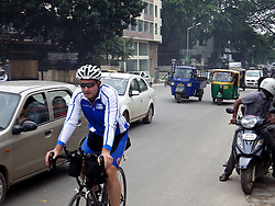 © Licensed to London News Pictures. 29/07/2013. Agra, Uttar Pradesh, India. James Ketchell world cycle/ global triathlon: riding through the crowded streets of Banaglore ; India's large tech city.-. The previous parts of this incredible and unique series were an Atlantic solo row in 2010 and summiting Everest in 2011.Photo credit : James Ketchell/LNP