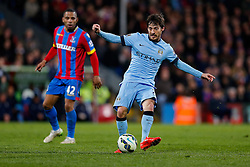 David Silva of Manchester City is challenged by Jason Puncheon of Crystal Palace - Photo mandatory by-line: Rogan Thomson/JMP - 07966 386802 - 06/04/2015 - SPORT - FOOTBALL - London, England - Selhurst Park - Crystal Palace v Manchester City - Barclays Premier League.