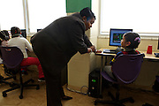 D.C. Public Schools Chancellor Kaya Henderson talks to second-grader Yocelyn Mendoza about her school work at Truesdell Education Campus on Friday, Nov. 16, 2012 in Washington, D.C. Henderson recently announced that she plans to close 20 under-enrolled schools across the district. CREDIT: Lexey Swall for The Wall Street Journal