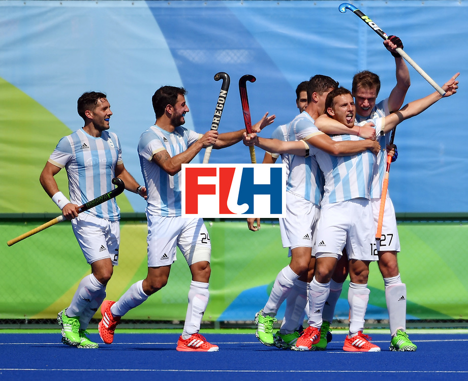 Argentina's Lucas Vila (2nd R) celebrates a goal with teammates during the men's semifinal field hockey Argentina vs Germany match of the Rio 2016 Olympics Games at the Olympic Hockey Centre in Rio de Janeiro on August 16, 2016. / AFP / Pascal GUYOT        (Photo credit should read PASCAL GUYOT/AFP/Getty Images)