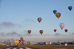 EDITORIAL USE ONLY<br /> 30 hot air balloons lift off from the runway at London City Airport as part of the RICOH Lord Mayor&Otilde;s Hot Air Balloon Regatta.