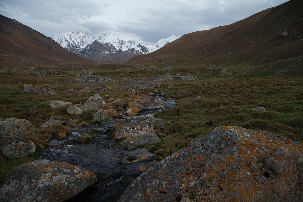 A stream flows down the valley out of the glaciers that line the flanks of Chok Tal peak.