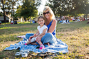Jennifer and Hayli Cech, 3, enjoy Fast Lane Band's performance during the Milpitas Summer Concert Series at Murphy Park in Milpitas, California, on July 14, 2015. (Stan Olszewski/SOSKIphoto)