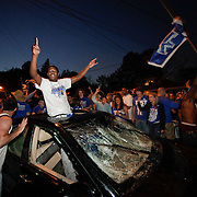 March 31, 2012 - Lexington, Kentucky, USA -  University of Kentucky basketball fans celebrates their team's victory over the University of Louisville in Lexington, Ky., on March 31, 2012. The win for Kentucky advances them to the championship game of the NCAA tournament in New Orleans. Fans took to the streets and in burned couches, turned over a car and ending with a handful of arrests. (Credit image: © David Stephenson/ZUMA Press)