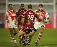 Paul Clough of Huddersfield Giants tackles Alex Walmsley (R) of St Helens during the Betfred Super League match at the John Smiths Stadium, Huddersfield<br /> Picture by Stephen Gaunt/Focus Images Ltd +447904 833202<br /> 23/02/2018