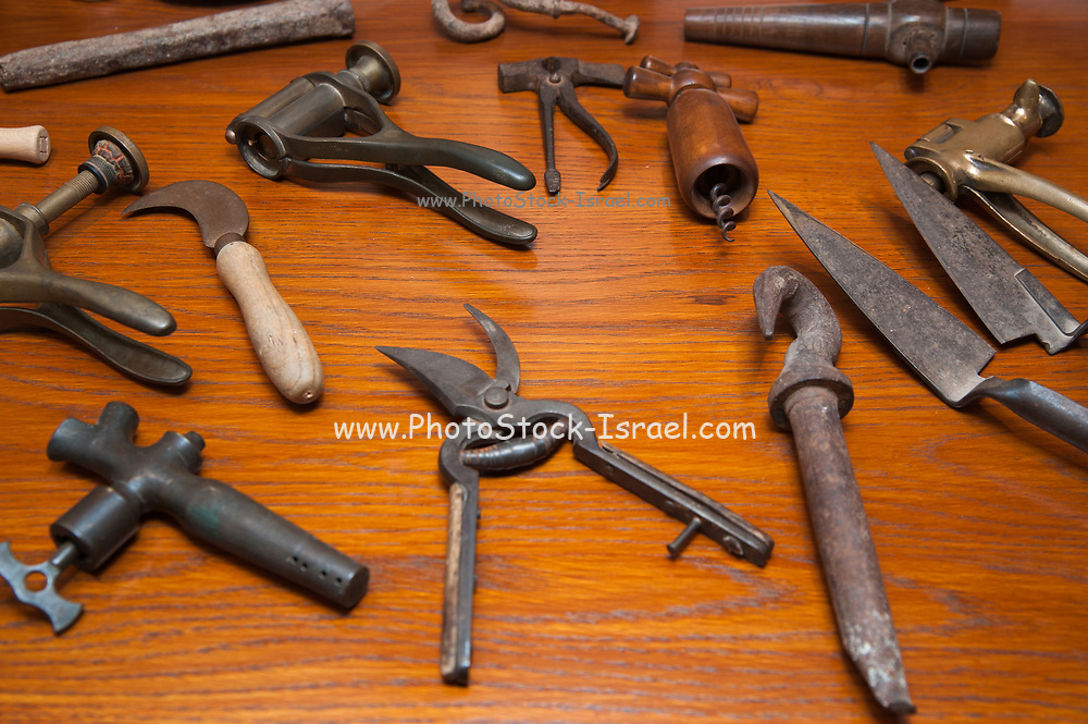 A display of old hand tools used for grape and wine industry