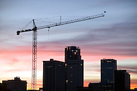 silhouette of buildings and crane for construction overlooking downtown Little Rock Arkansas at sunset