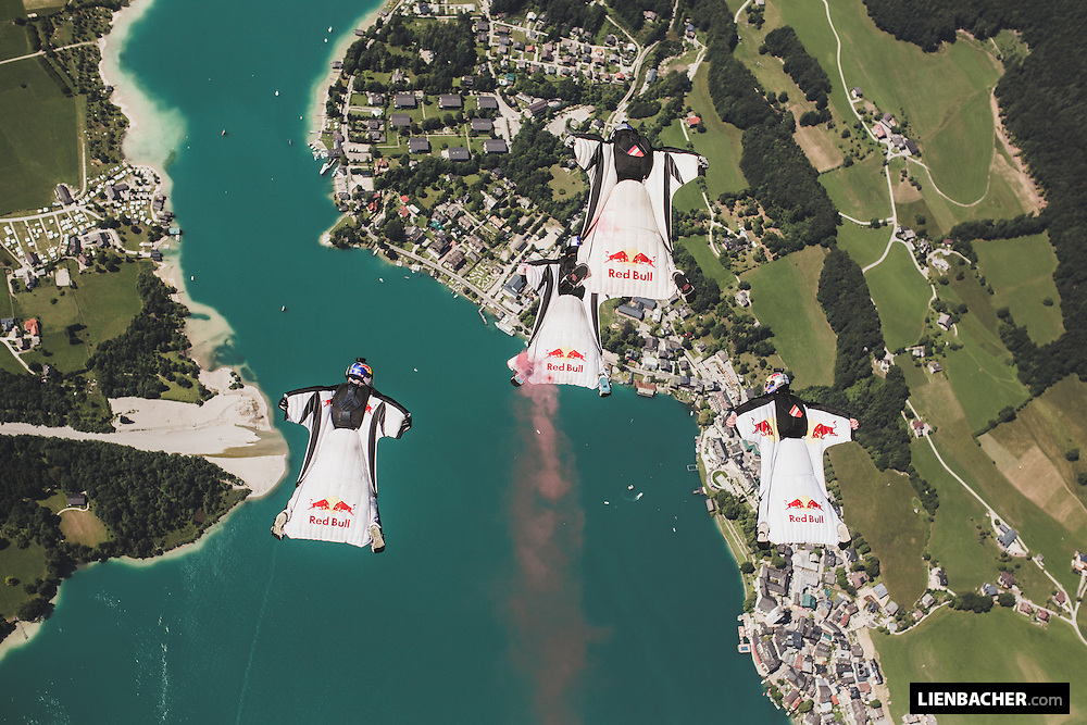 The Red Bull Skydive Team in a tight wingsuit formation over St. Wolfgang