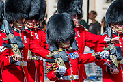 Some Guardsmen (women) are getting much shorter - Bands and Guardsmen march down the Mall - His Royal Highness the Duke of York reviews the final rehearsal for the Trooping the Colour on Horseguards Parade and the Mall.