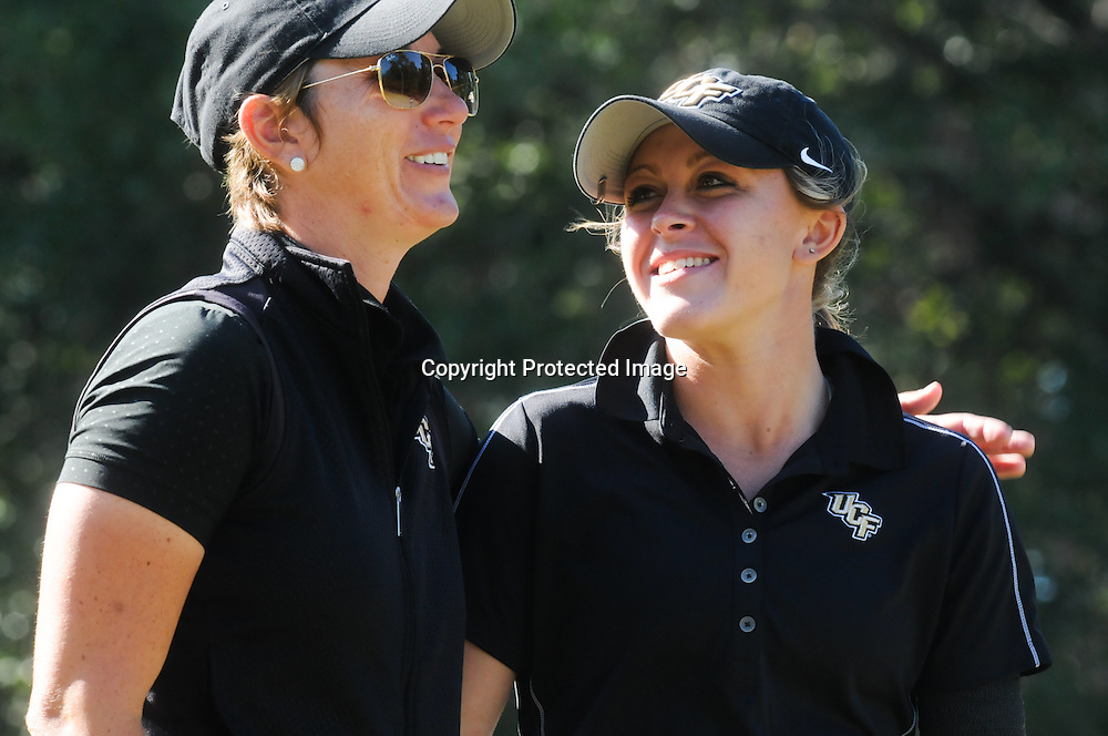 The University of Central Florida's Ashley Holder, right, shares a laugh with Coach Emily Marron Sunday October 26, 2014 during the 13th annual Landfall Tradition in Wilmington, N.C. (Jason A. Frizzelle)