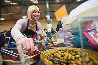 Stallholder serving customer<br /> Brecon Food Festival 2009<br /> Market Hall<br /> Brecon<br /> South<br /> Food