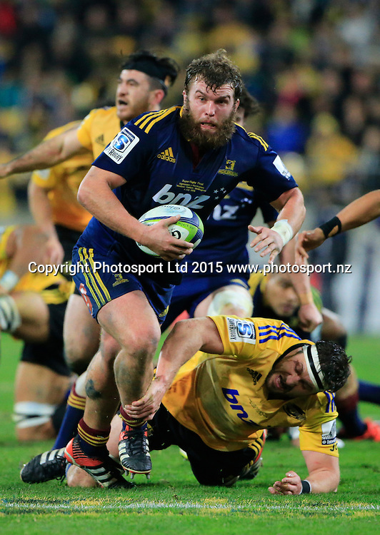 Mark Reddish steps through the tackle of Jeremy Thrush.  Super Rugby Final, Hurricanes v Highlanders. Westpac Stadium, Wellington, New Zealand. 4 July 2015. Copyright Photo: John Cowpland / www.photosport.nz