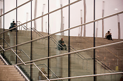 HANNOVER, GERMANY - MARCH-6-2008 - Visitors relax on the giant staircase outside and inside hall 9 at CeBIT, the world's largest computer fair, which attracts hundreds of thousands of visitors every year. (Photo © Jock Fistick)