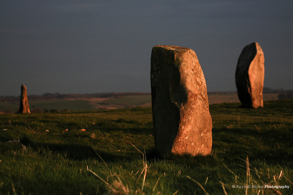 Standing stones at sunset in Avebury, Wiltshire, UK