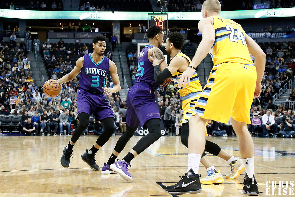 04 March 2017: Charlotte Hornets guard Jeremy Lamb (3) drives past Denver Nuggets guard Jamal Murray (27) on a screen set by Charlotte Hornets forward Christian Wood (35) during the Charlotte Hornets 112-102 victory over the Denver Nuggets, at the Pepsi Center, Denver, Colorado, USA.