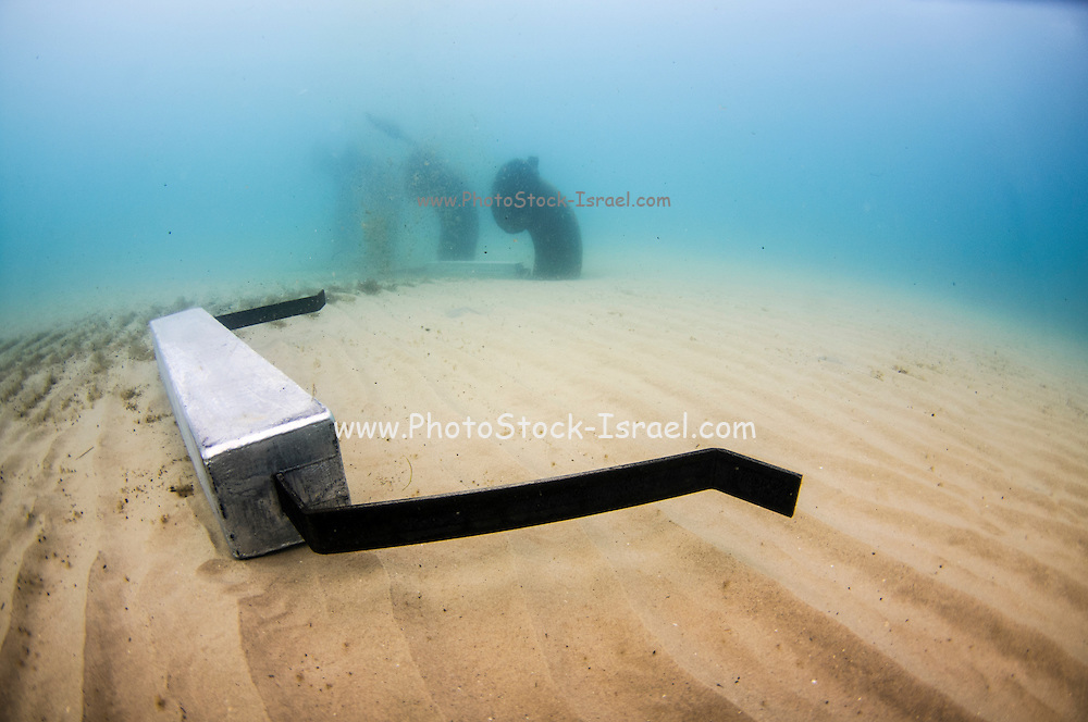 Zinc anode on the ocean floor. Sacrificial Zinc anodes are attached to underwater metal parts to reduce corrosion