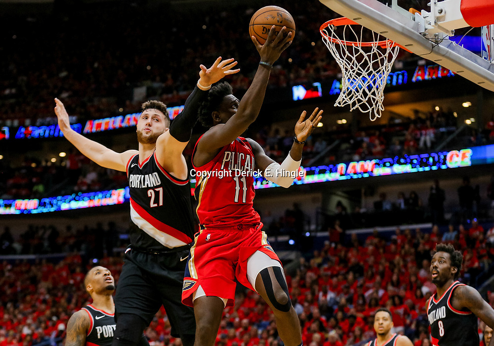 Apr 21, 2018; New Orleans, LA, USA; New Orleans Pelicans guard Jrue Holiday (11) shoots over Portland Trail Blazers center Jusuf Nurkic (27) during the second half in game four of the first round of the 2018 NBA Playoffs at the Smoothie King Center. Mandatory Credit: Derick E. Hingle-USA TODAY Sports