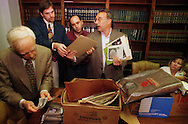 From left, Dr. Norman Johnston, Sean Kelley, 29, of Philadelphia, PA., Milton Marks, 37, of Philadelphia, PA., and Mel Kardos look at some of the artifacts at Kardos' office in Newtown, Pa., Thursday, Aug. 14, 1997. On the right seated is Donna Sheerer, 42, of Levittown, PA. The Sheerer family, of Philadelphia, donated the photo and various artifacts from Eastern State Penitentiary in Philadelphia.  (photo by William Thomas Cain) WILLIAM THOMAS CAIN NEWSMAKERS