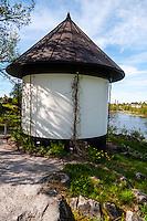 Sweden, Stockholm. Bergianska trädgården. Small, round building.