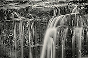 Falling curtains of water in black-and-white, on the Ellis River in Jackson New Hampshire.
