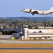 11/22/09 -- BRUNSWICK, Maine. U.S. Navy Cmdr. Michael Parker, Commanding Officer for Patrol Squadron 26 (VP-26),  flies a P-3 off of runway 1 with a crew from Naval Air Station (NAS) Brunswick on Sunday, headed for a deployment in Africa. The squadron will deploy it's last two planes on Sunday after Thanksgiving. Following the deployment, VP-26 will return to Jacksonville, Fla., because NAS Brunswick is slated to close in 2011.  VP-26 is the last squadron to leave NAS Brunswick. Photo by Roger S. Duncan