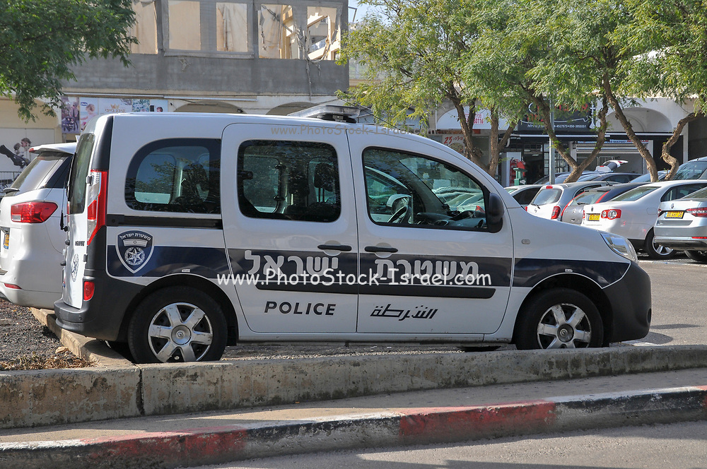 Israeli police van in blue and white photographed in Tiberias, Israel