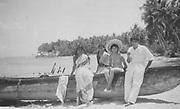 Rita White at Passekuda Beach on the East Coast with Doctor Rasiah and two nurses from Batticaloa Hospital.<br /> 1957