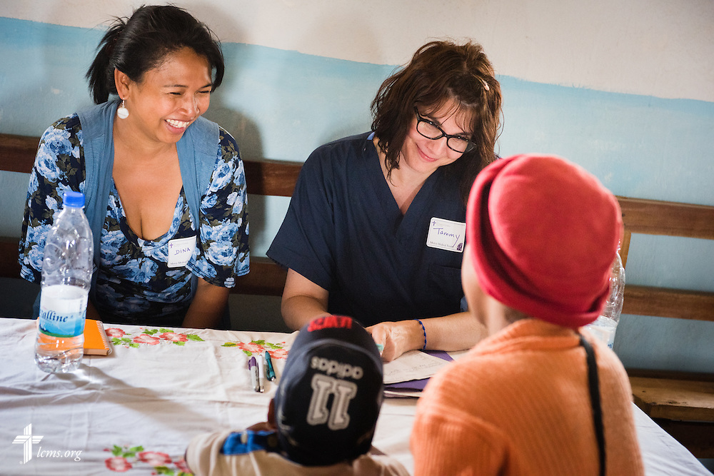 Tamara Taylor with the Mercy Medical Team works with patients Saturday, Oct. 18, 2014, at a Fiangonana Loterana Malagasy (FLM) Lutheran church in Antsoantany, Madagascar. LCMS Communications/Erik M. Lunsford