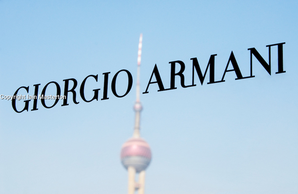 Detail of name plate of Giorgio Armani shop in Shanghai with reflection of Pearl Oriental Tower