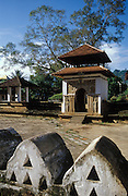 Kandy town, in front of the Temple of the Tooth. A gateway between shrines and temples. Entrance to Sri Natha Devale.