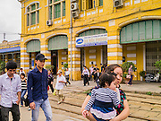 06 APRIL 2012 - HAI PHONG, VIETNAM: Passengers leave the Hai Phong train station to board the train to Hanoi. The Hanoi to Hai Phong Express Train runs several times a day between Long Bien Station in Hanoi and the Hai Phong Station. Hanoi is the capital of Vietnam and Hai Phong is the 4th largest city in Vietnam. Hai Phong is the principal industrial port in the northern part of Vietnam. It was heavily bombed and mined during the American War (what Americans call the Vietnam War).   PHOTO BY JACK KURTZ