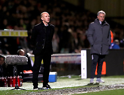 Yeovil Town manager Darren Way (left) and Manchester United manager Jose Mourinho (right) during the Emirates FA Cup, fourth round match at Huish Park, Yeovil.