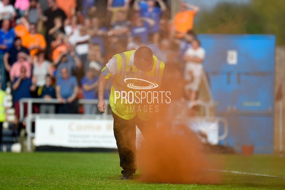 A flare on the pitch thrown from the Oldham fans  during the EFL Sky Bet League 1 match between Northampton Town and Oldham Athletic at Sixfields Stadium, Northampton, England on 5 May 2018. Picture by Dennis Goodwin.