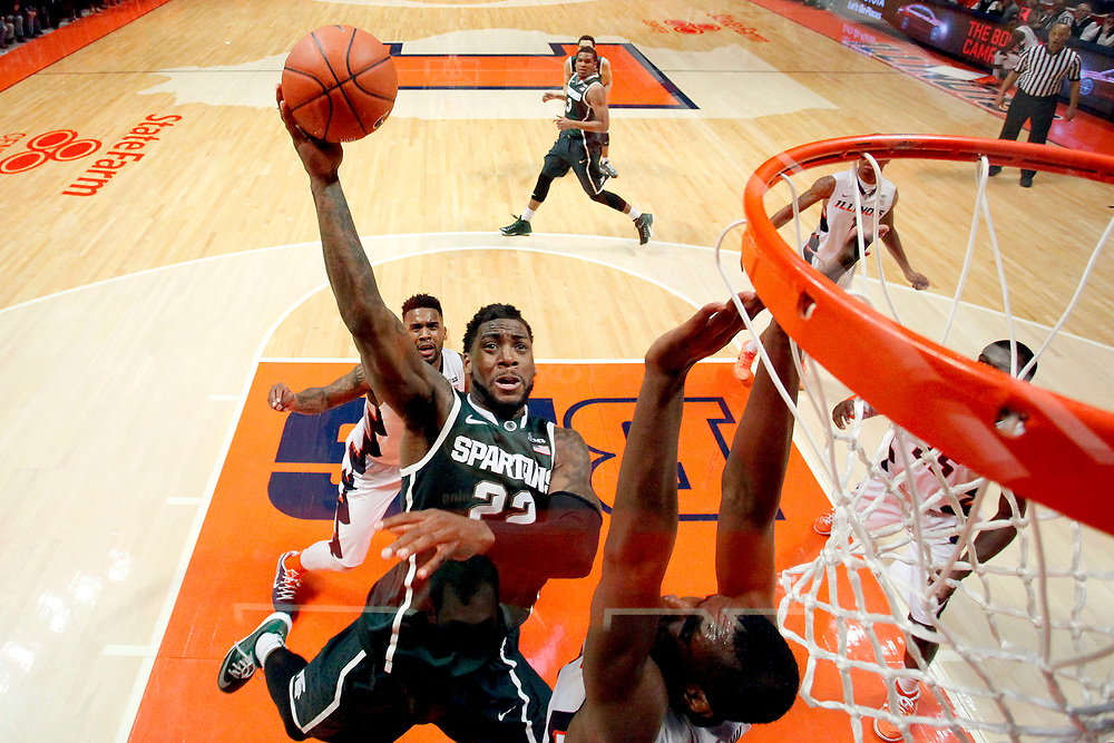 Michigan State guard/forward Branden Dawson (22) shoots against Illinois forward/center Nnanna Egwu (32) and guard Rayvonte Rice (24) during an NCAA college basketball game at the State Farm Center Sunday, Feb. 22, 2015, on the University of Illinois campus in Champaign, Ill. Michigan State won the game 60-53. (For the Herald & Review/ Stephen Haas)