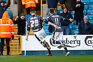Martyn Woolford of Millwall (right) celebrates scoring his team's first goal to make it 1-1 with Scott Malone of Millwall (left) during the Sky Bet Championship match at The Den, London<br /> Picture by David Horn/Focus Images Ltd +44 7545 970036<br /> 15/02/2014