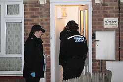 © Licensed to London News Pictures. 17/03/2019. London, UK.  Officers are seen at a house being searched in Viola Avenue in Stanwell after police said that they are treating a stabbing incident last night as a terrorism. Counter Terrorism Policing South East are leading an investigation into an incident last night, which has now been declared a terrorist incident, following the arrest of a man on suspicion of attempted murder and racially aggravated public order in Stanwell. Photo credit: Peter Macdiarmid/LNP