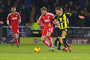 Chesterfield FC midfielder Gary Liddle and Burton Albion midfielder Tom Naylor battle it out for the ball during the Sky Bet League 1 match between Burton Albion and Chesterfield at the Pirelli Stadium, Burton upon Trent, England on 12 February 2016. Photo by Aaron Lupton.