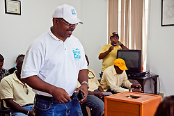 """Donald """"Ducks"""" Cole draws #22 for the Office of the Senate, St. Thomas-St. John district.  Casting of Lots for the Primary Election of September 8, 2012.  Election Sytem of the Virgin Islands.  21 August 2012.  © Aisha-Zakiya Boyd"""