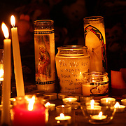 Candles alight as children and families pay their respects to a shrine around the statue of Mother Mary at the Rose Lima church in Newtown Sandy Hook after yesterday's shootings at Sandy Hook Elementary School, Newtown, Connecticut, USA. 15th December 2012. Photo Tim Clayton