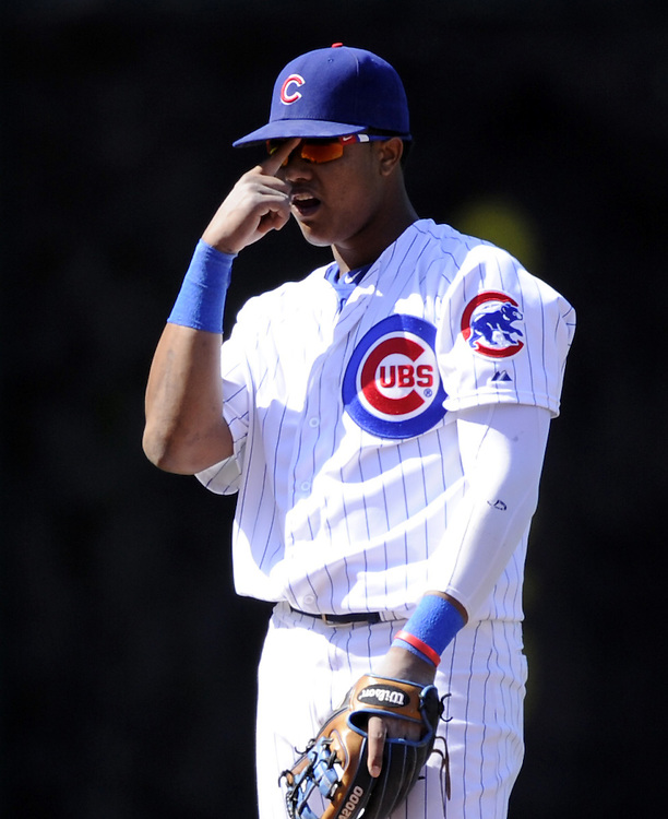 CHICAGO - MAY 08:  Starlin Castro #13 of the Chicago Cubs adjusts his sunglasses during the game against the St. Louis Cardinals on May 8, 2013 at Wrigley Field in Chicago, Illinois.  The Cardinals defeated the Cubs 5-4.  (Photo by Ron Vesely)  Subject:   Starlin Castro