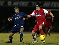Photo: Chris Ratcliffe.<br /> Southend United v Swindon Town. Coca Cola League 1. 27/01/2006.<br /> Luke Guttridge (L) of Southend and Lee Peacock of Swindon tussle for the ball