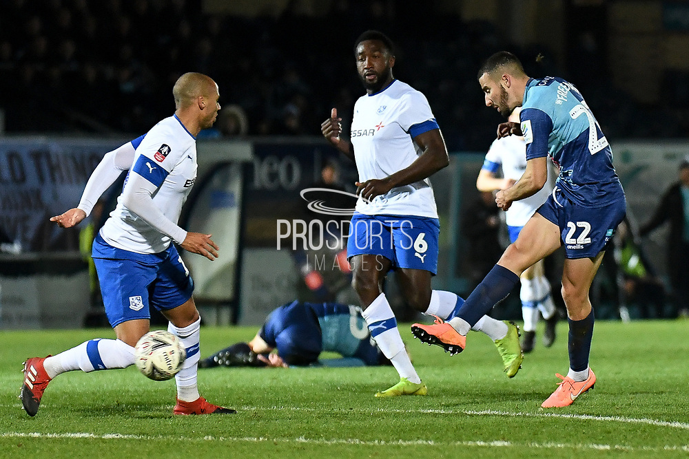 Wycombe Wanderers midfielder Nick Freeman (22) takes a shot at goal during the The FA Cup match between Wycombe Wanderers and Tranmere Rovers at Adams Park, High Wycombe, England on 20 November 2019.