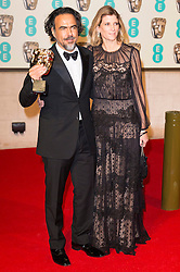 © Licensed to London News Pictures. 14/02/2016. London, UK. ALEJANDRO GONZALEZ INARRITU and wife MARIA ELANDIA HAGERMANN arrive carpet for the EE British Academy Film Awards 2016 after party held at Grosvenor House . London, UK. Photo credit: Ray Tang/LNP Photo credit: Ray Tang/LNP
