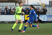 Southend United goalkeeper Mark Oxley (1) just beating AFC Wimbledon attacker Egli Kaja (21) to the ball during the EFL Sky Bet League 1 match between AFC Wimbledon and Southend United at the Cherry Red Records Stadium, Kingston, England on 1 January 2018. Photo by Matthew Redman.