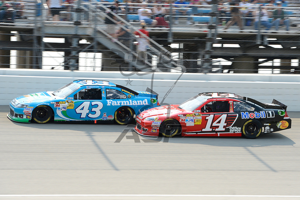 Joliet, IL - SEP 16, 2012: Aric Almirola (43) and Tony Stewart (14) race during the Geico 400 at the Chicagoland Speedway in Joliet, IL.