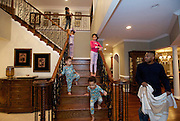 Shaun Alexander gets ready for bedtime with his wife Valerie (top), children Eden, 6 yrs-old, Heaven, 10, Justus, 2, and Joseph, 4, in their home in Great Falls, VA. January 21, 2014.